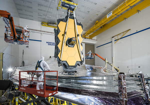 Technicians watch as NASA's James Webb Space Telescope unfurls its sunshield during a final pre-launch test at the Northrop Grumman facility in Redondo Beach, California.