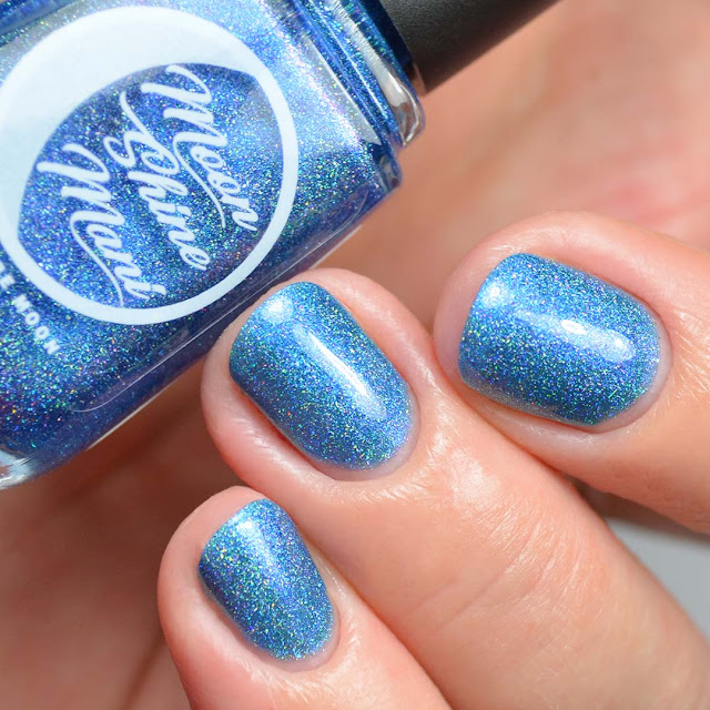 blue nail polish with shimmer in a bottle