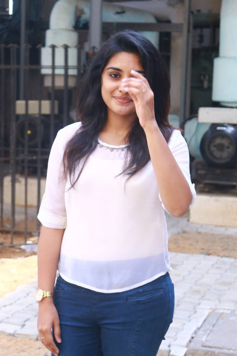 Niveda Thomas Photos In White Top Blue Jeans