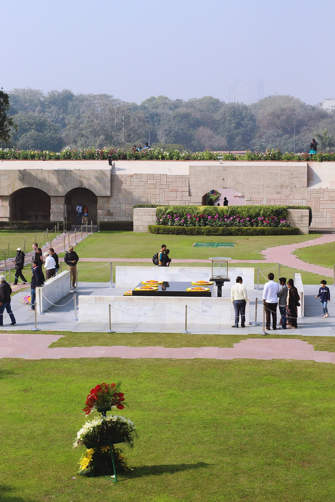 Peaceful gardens with the black marble platform of Gandhi's memorial