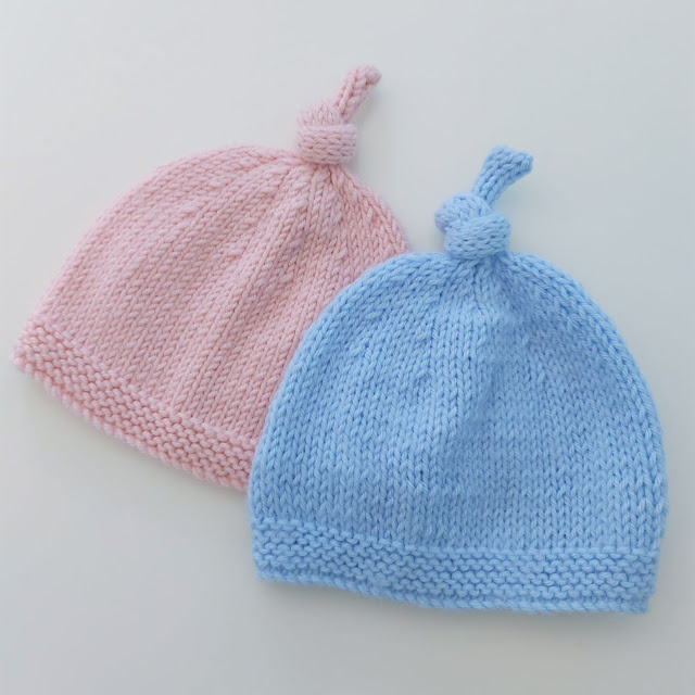 Cute knitted baby hat with topknot