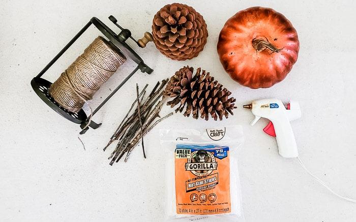 supplies to make pine cone pumpkin