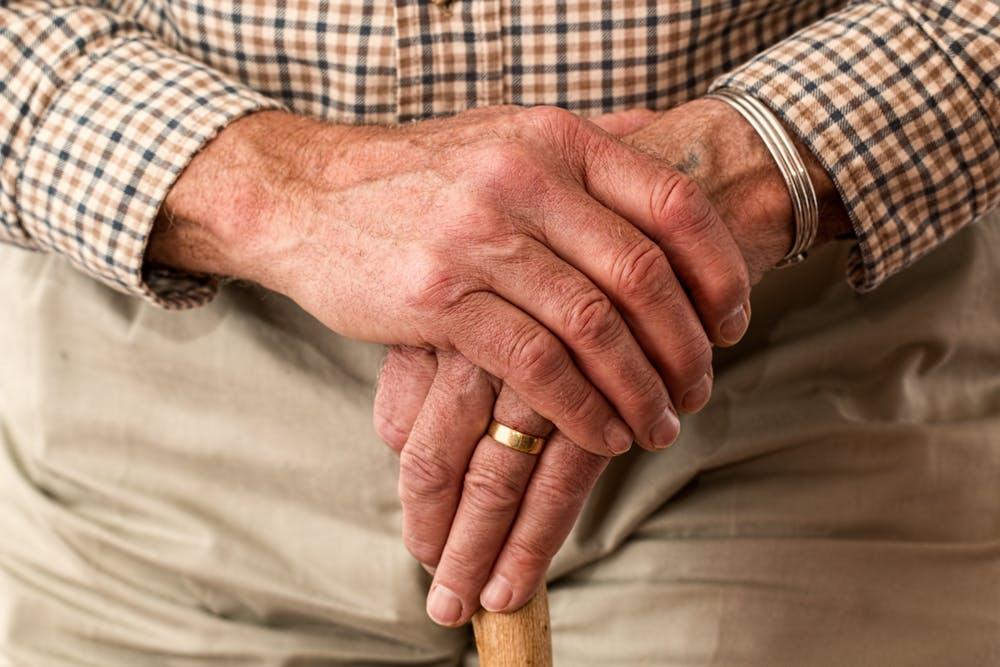 Pexels image of elderly man with walking stick
