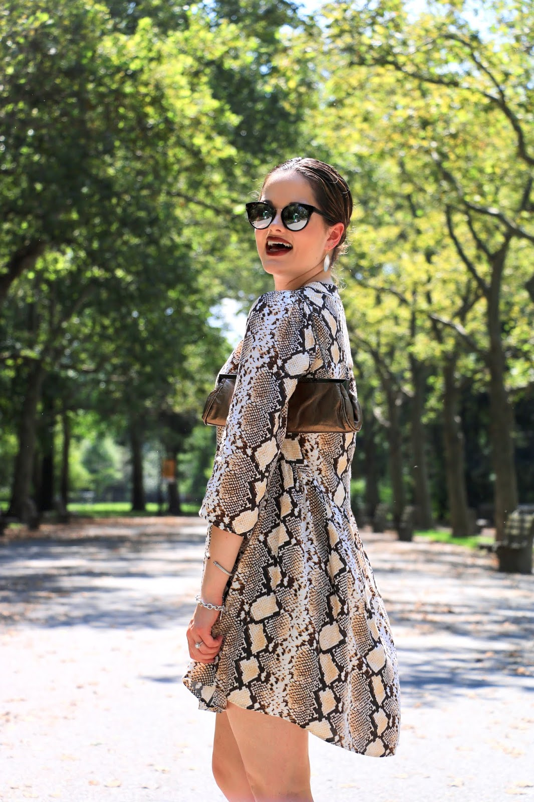 Nyc fashion blogger Kathleen Harper wearing an animal print dress for fall 2019.