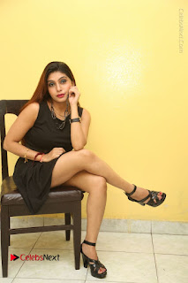 Tollywood Upcoming Actress Pooja Roshan Stills in Black Short Dress at Plus 1 Movie Trailer Launch  0321.JPG
