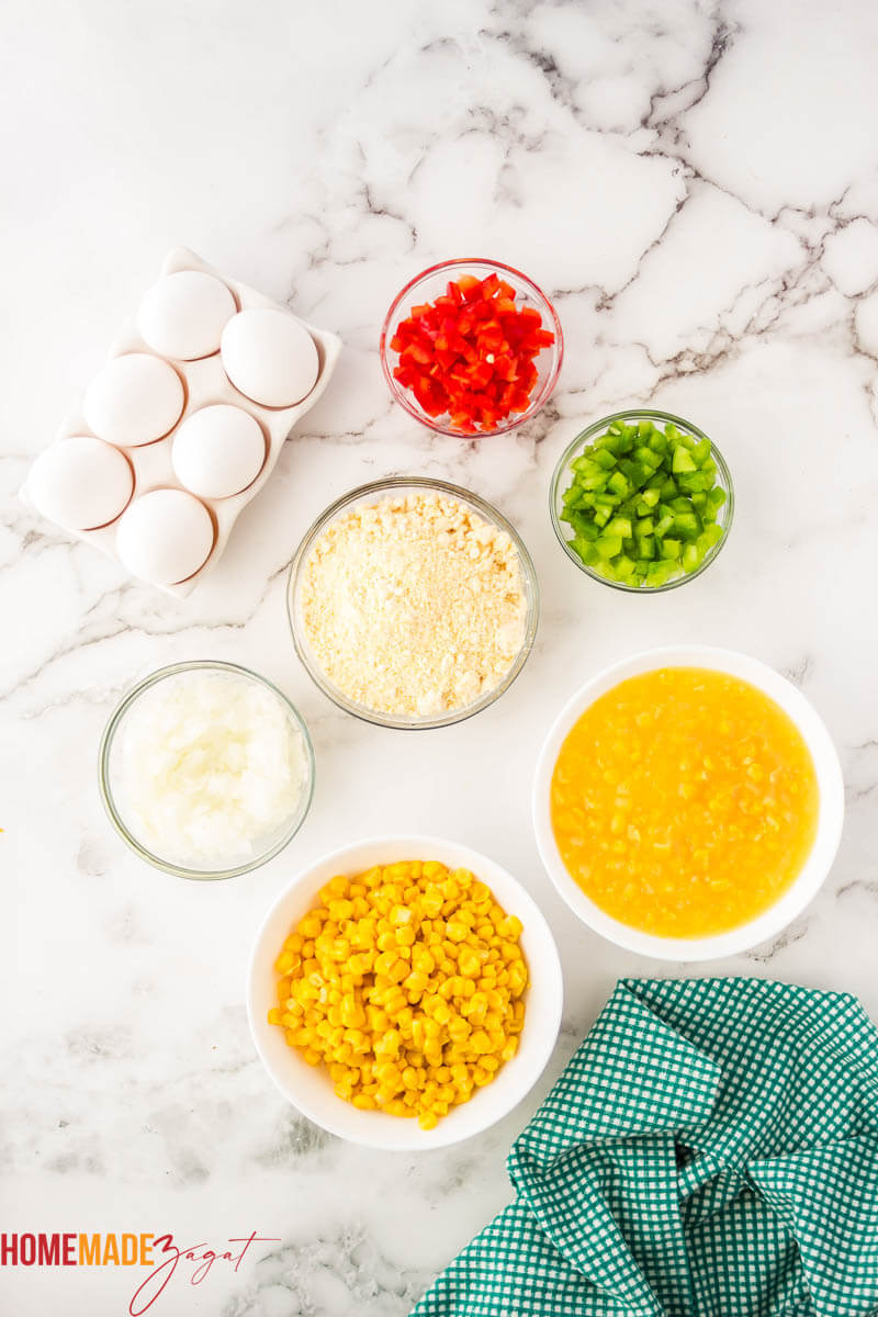 Eggs, bell peppers, corn mix, corn butter. Ingredients needed for pie, distributed out
