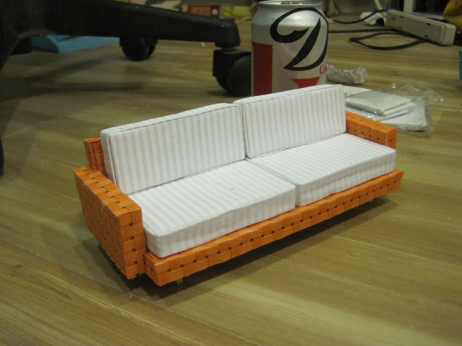 online white souvenirs toys miniature isolated and couch background picture on stock