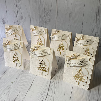 A collection of Christmas Cards in Vanilla and Gold Foil using Stampin' Up! Pine Wood Dies