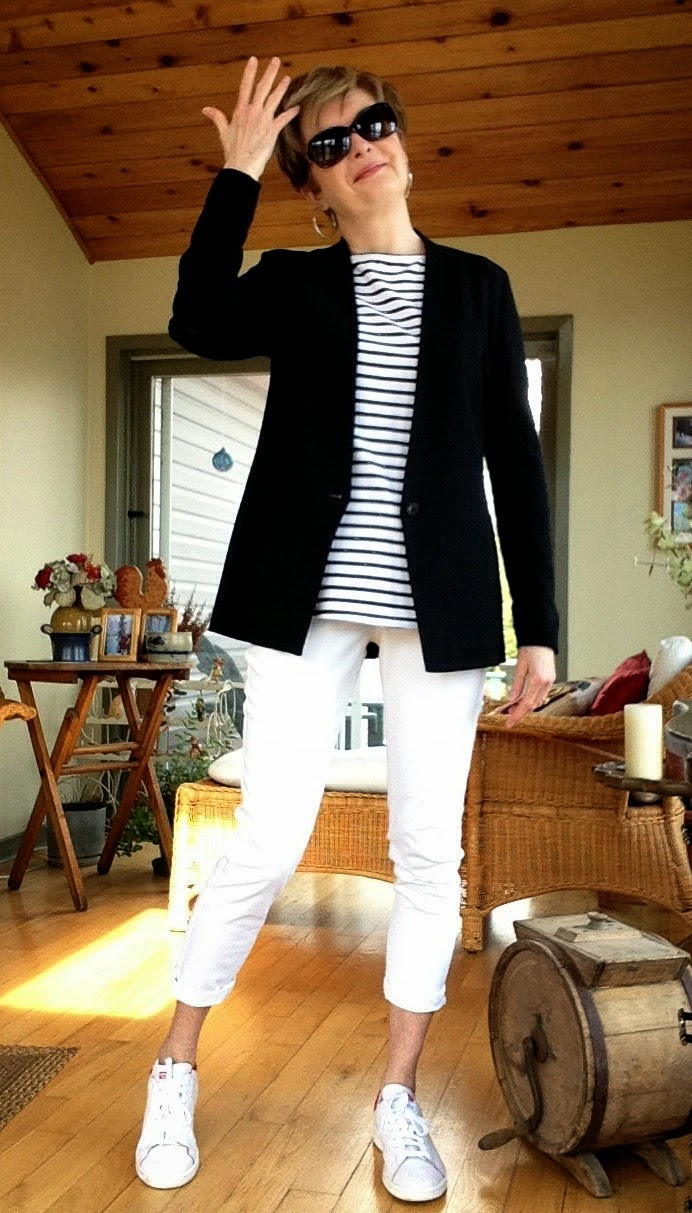 Black Helmut Lang jacket, white NYDJ jeans, striped A&G tee shirt and Addidas Stan Smith sneakers
