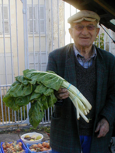 Old gardener with his produce at a village market, Indre et Loire, France. Photo by Loire Valley Time Travel.