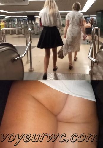 Upskirts 4198-4207 (Secretly taking an upskirt video of beautiful women on escalator)