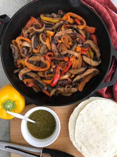 Skillet filled with cooked portabello mushroom fajita filling.