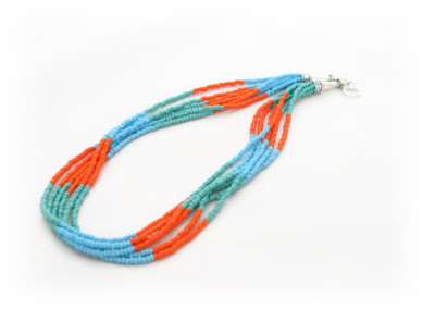 A seed bead multi strand necklace in turquoise & orange by Lottie Of London