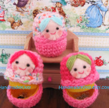 http://translate.google.es/translate?hl=es&sl=en&tl=es&u=http%3A%2F%2Fhandmadekittyblog.blogspot.com.es%2F2013%2F03%2Fmatryoshka-russian-dolls-cases-crochet.html