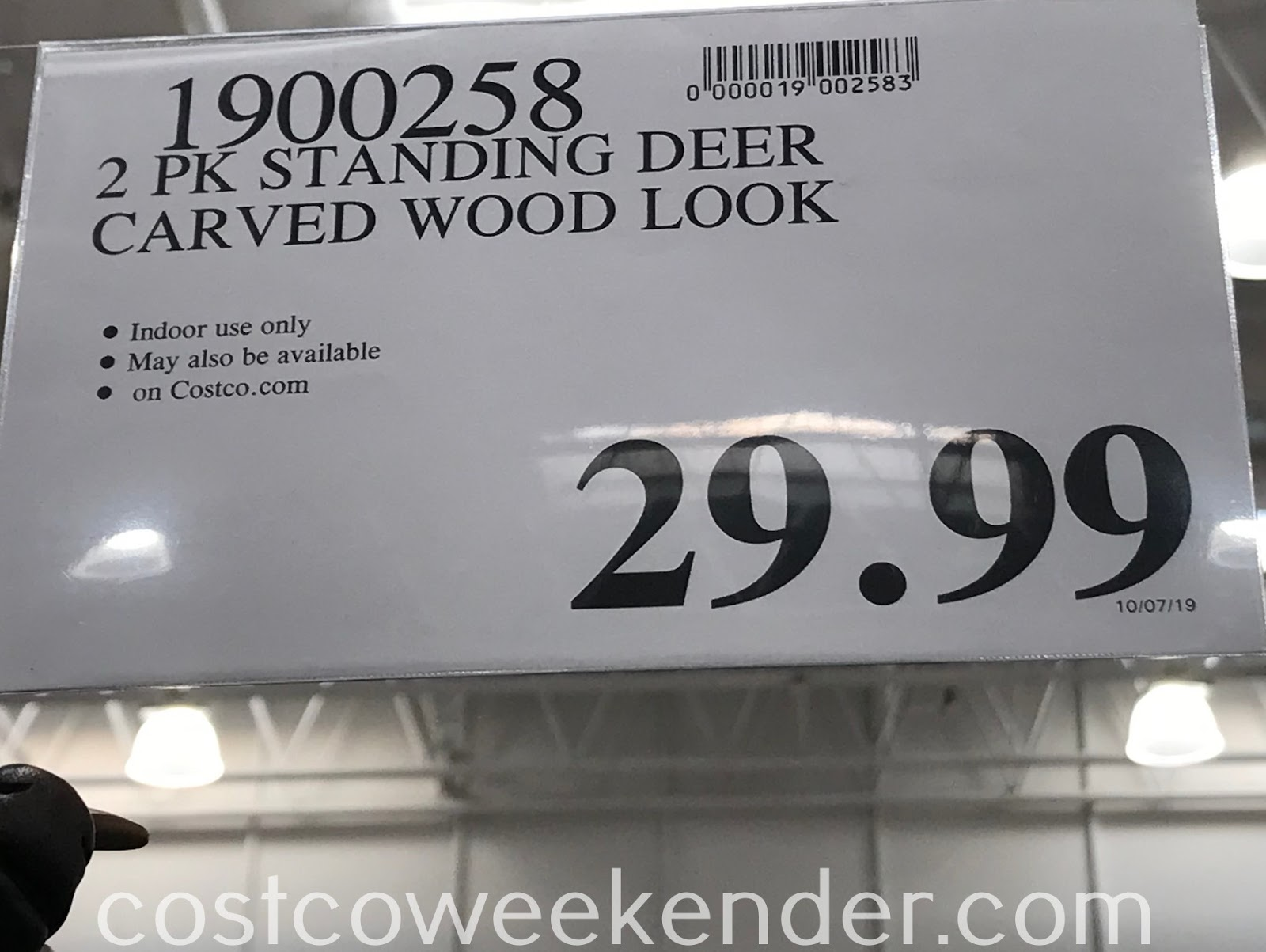 Deal for a 2 pack of Decorative Carved Wood Look Deer at Costco