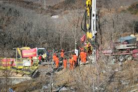 Chinese rescuers drill new 'lifelines' to trapped gold miners