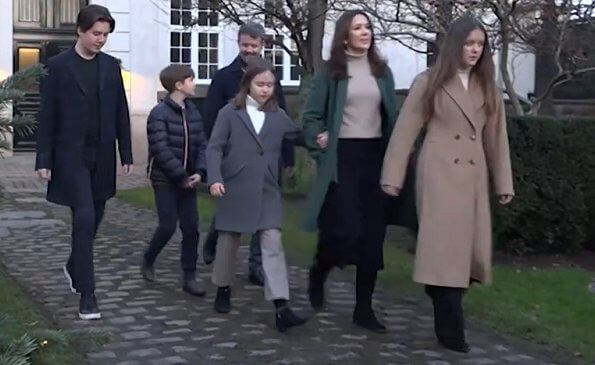 Princess Isabella wore a turtleneck sweater from Zara. camel wool coat. Crown Princess Mary wore a green wool and cashmere coat from Theory