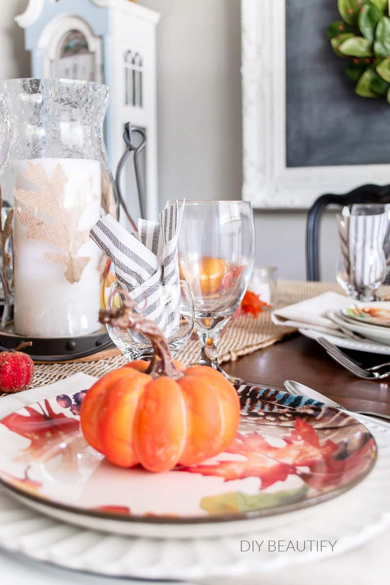 fall table with orange pumpkins