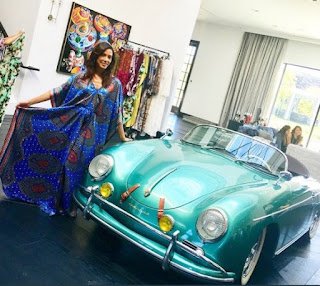 Kristen Baker Bellamy posing for picture with a classic car