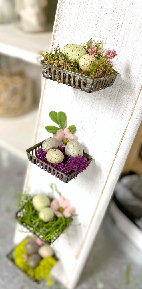 Repurposed metal soap baskets with Easter eggs