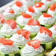 Festive Green and Red Healthy Cucumber Hummus Bites