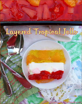 Layered Tropical Jello, a refreshing summer treat. Simple to assemble, but requires time for the layers to set so make this one a day ahead. | Recipe developed by www.BakingInATornado.com | #recipe #dessert