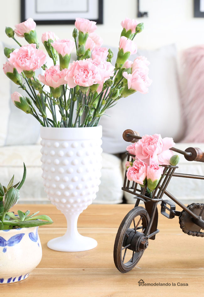 Coffee table Spring decor - Tulips inside milkglass cup and little bike