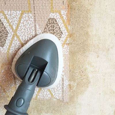removing wallpaper with a steam mop