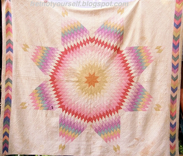 Lone Star quilt of pastel solids from 1920s Oklahoma.
