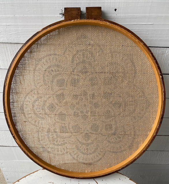 Photo of the back of burlap fabric on quilting hoop
