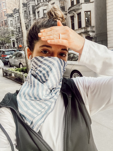 Nyc fashion blogger Kathleen Harper wearing a bandana face mask in NYC.