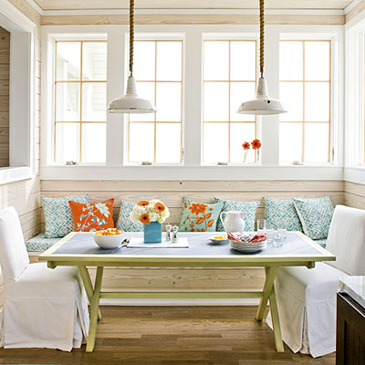 eating nook with orange pillows