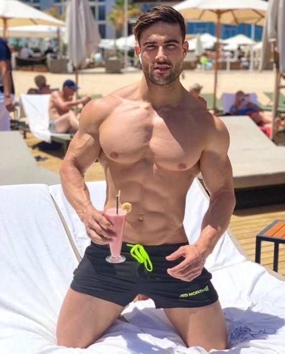 seductive-muscular-gay-guys-shirtless-body-pecs-drinking-cocktail-beach