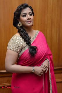 Actress Varalakshmi Pictures in Pink Saree at Madha Gaja Raja Audio Launch  0005