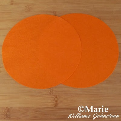 2 overlapped circles of orange color felt fabric