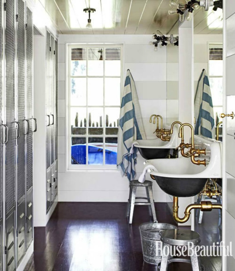 boathouse horizontal stripe on the walls, brass pipe fittings and exposed bulb lighting give this bathroom a nautical feel.