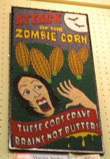Attack of the Zombie Corn, looks like a 50s horror poster, colorful with dyed seeds