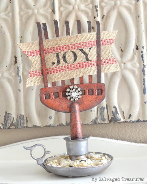Repurposed rusty rake DIY candle holder with jute webbing