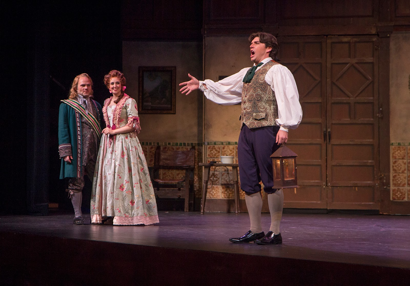 IN PERFORMANCE: (from left to right) tenor ANDREW OWENS as Conte Almaviva, mezzo-soprano CECELIA HALL as Rosina, and baritone DAVID PERSHALL as Figaro in Greensboro Opera's production of Gioachino Rossini's IL BARBIERE DI SIVIGLIA, January 2018 [Photo by Star Path Images, © by Greensboro Opera]