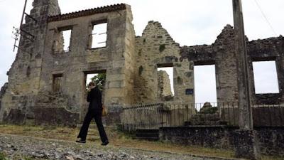 Oradour-sur-Glane France Nazi massacre memorial graffiti war crime genocide
