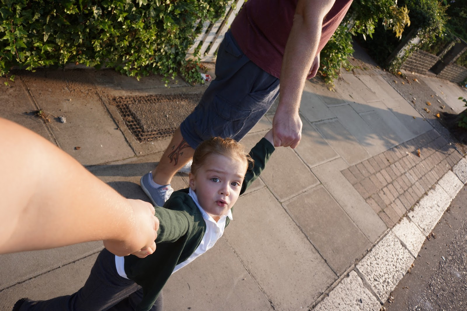 pulling mummy along while walking to school