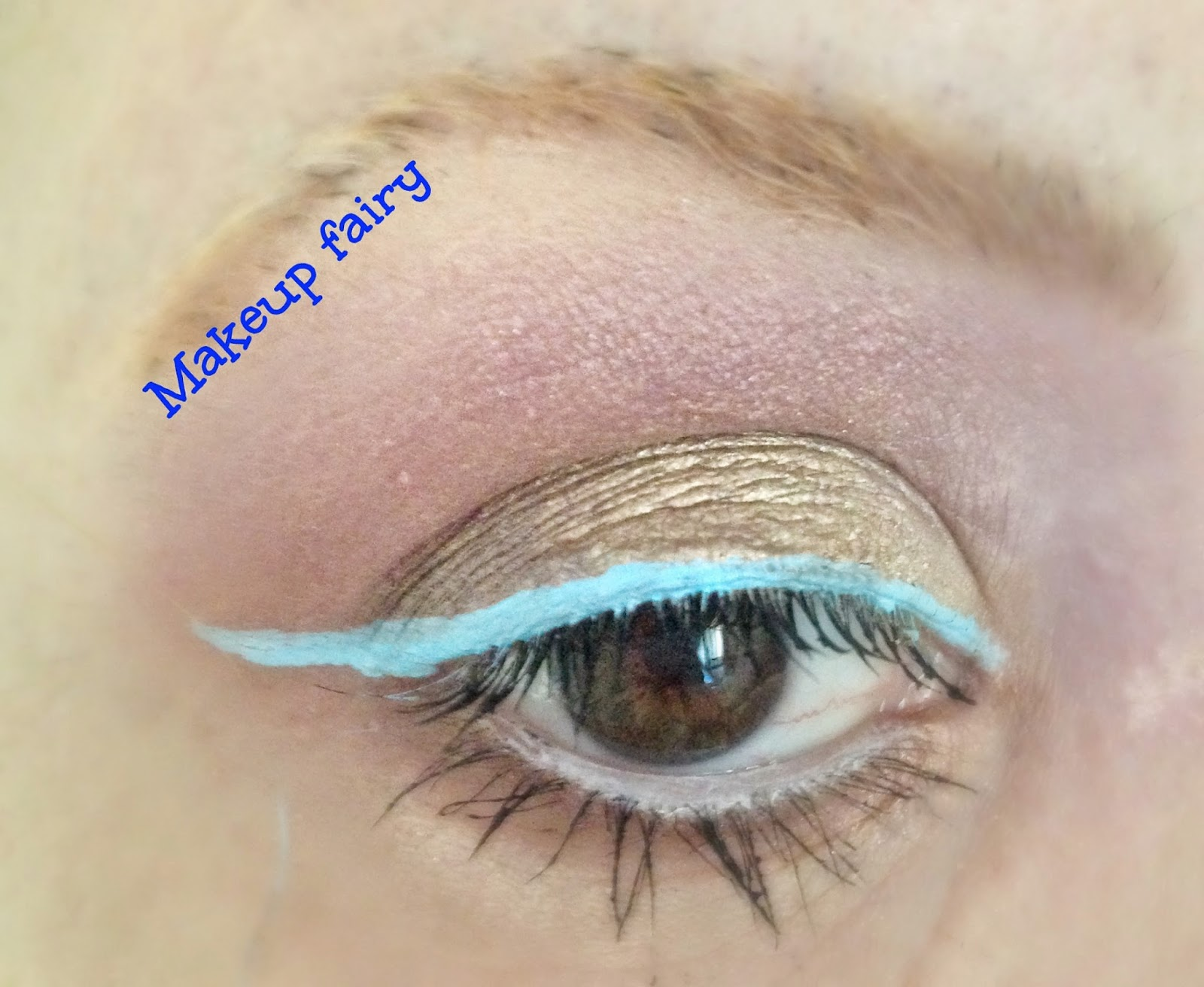 eye makeup look rose gold with a pop of pastel blue