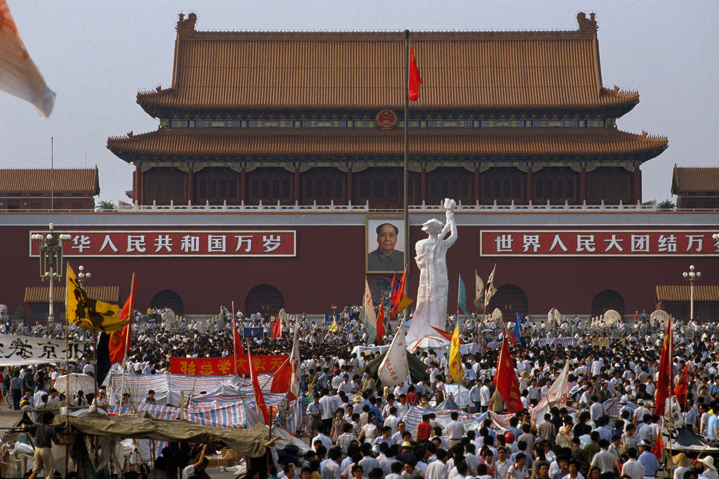 the protest at tiananmen square Waving banners, high school students march in beijing streets near tiananmen square on may 25, 1989, during a rally to support the protest against the chinese government.