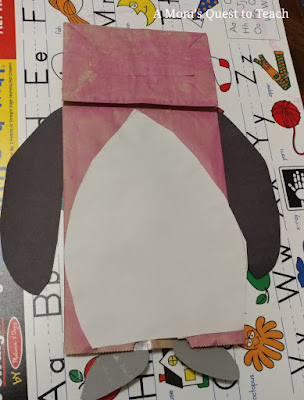 paper bag penguin puppet with wings, belly, and feet