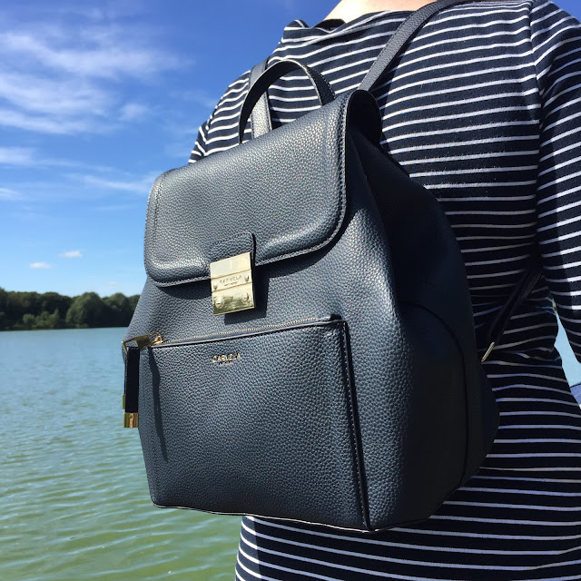 Mrs Bishop wearing the Carvela by Kurt Geiger Navy Backpack