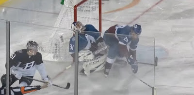 hockey ian cole hits grubauer