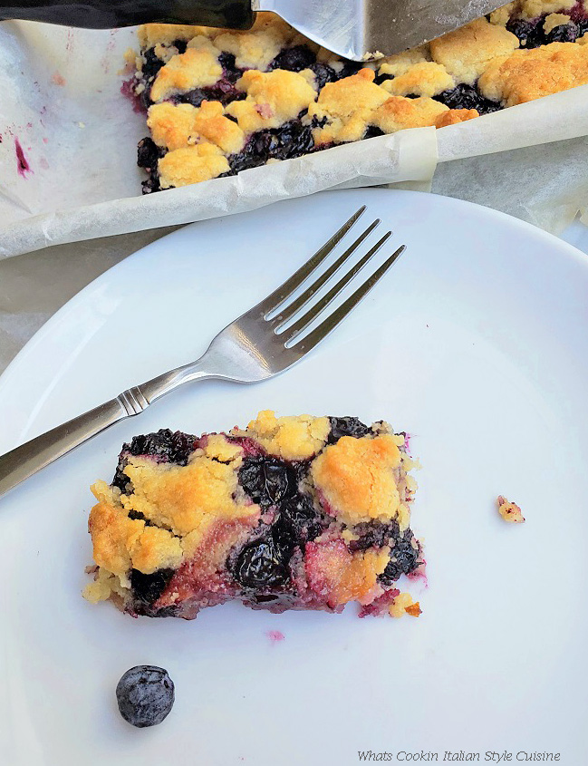 blueberry bar with a fork on a white plate
