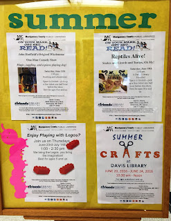 Bulletin board showing summer programs at Davis Library