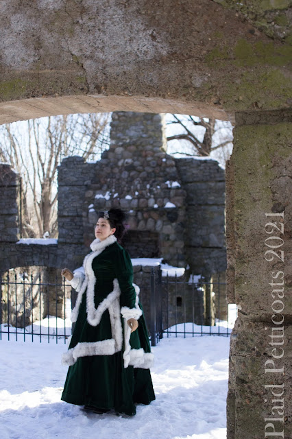 on the second level with another archway and the large fireplace and chimney in the background