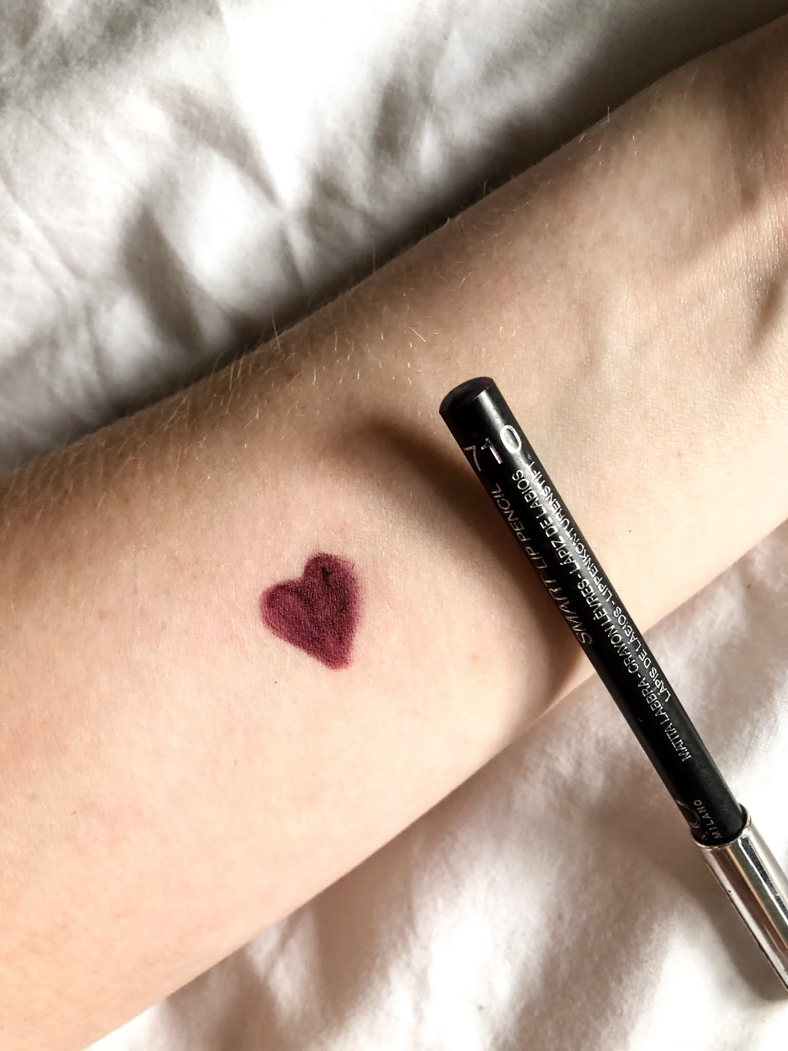 Kiko lip pencil review and swatches of deep violet.